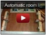 Automatic room light controller with visitor counter
