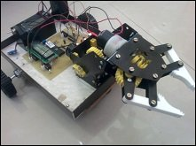Touch screen controlled 2 axis Pick and Place robot using wireless communication